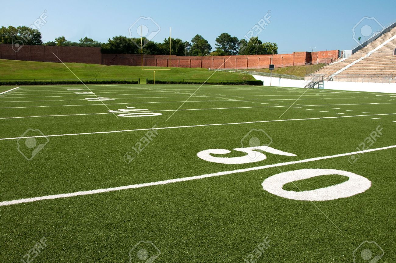 American football field with goal post in background. Stock Photo - 7625540