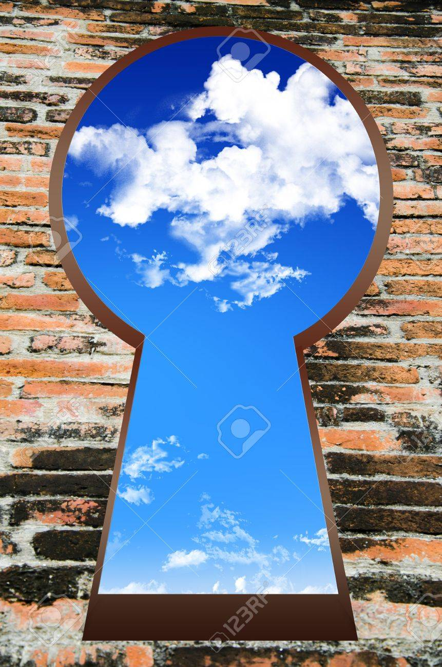 Blue Sky Seen Through The Keyhole on Brick Wall Stock Photo - 14605109