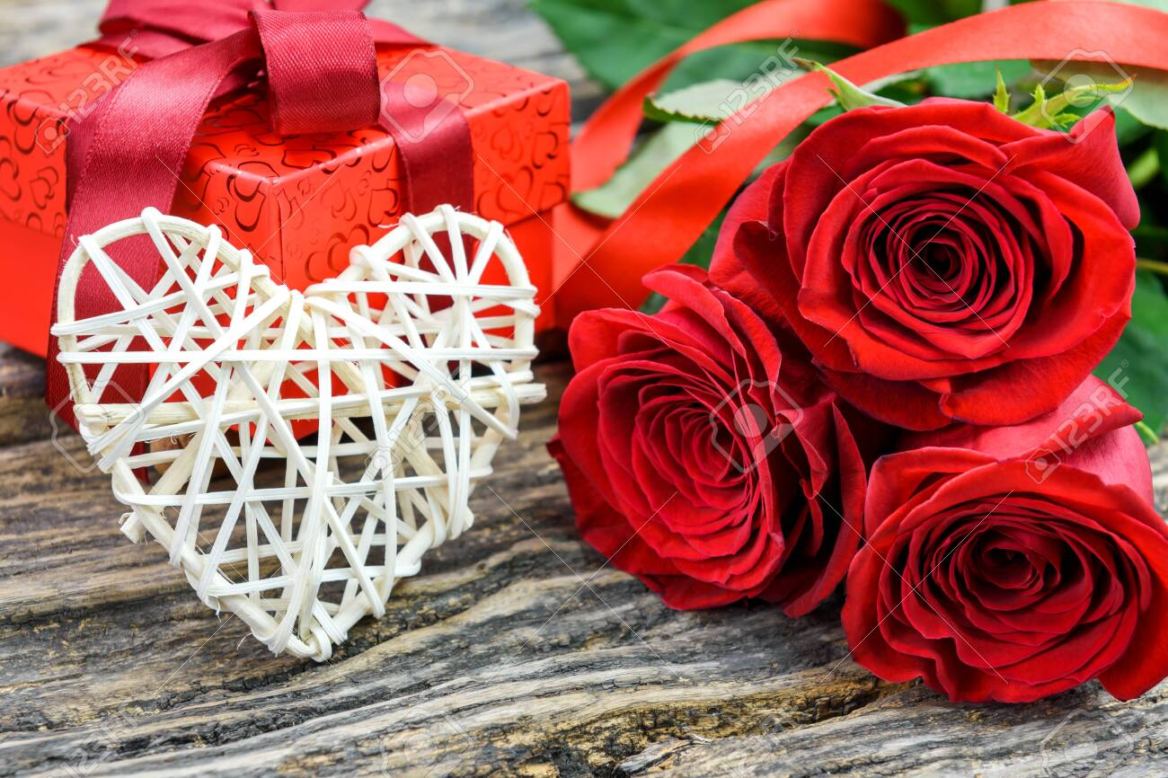 Valentines Day And Womens Day Concept. Red Roses, Gift Box.. Stock Photo,  Picture And Royalty Free Image. Image 139260130.