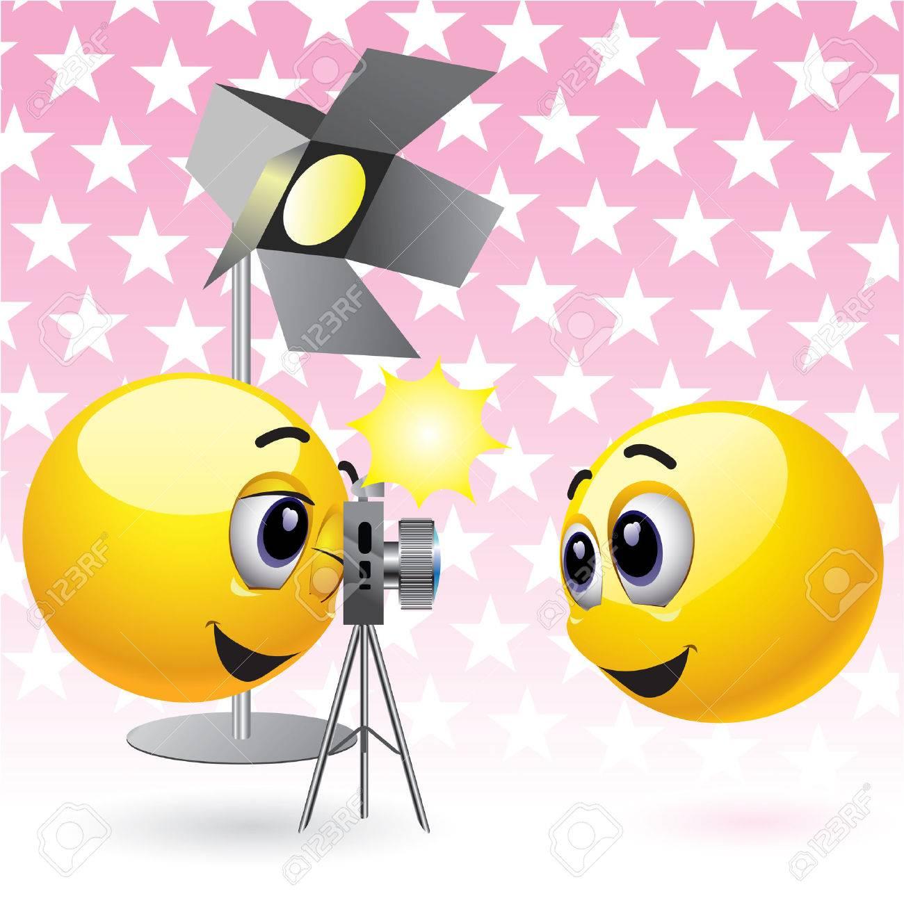 Smiling balls taking photographs in studio Stock Vector - 4667307