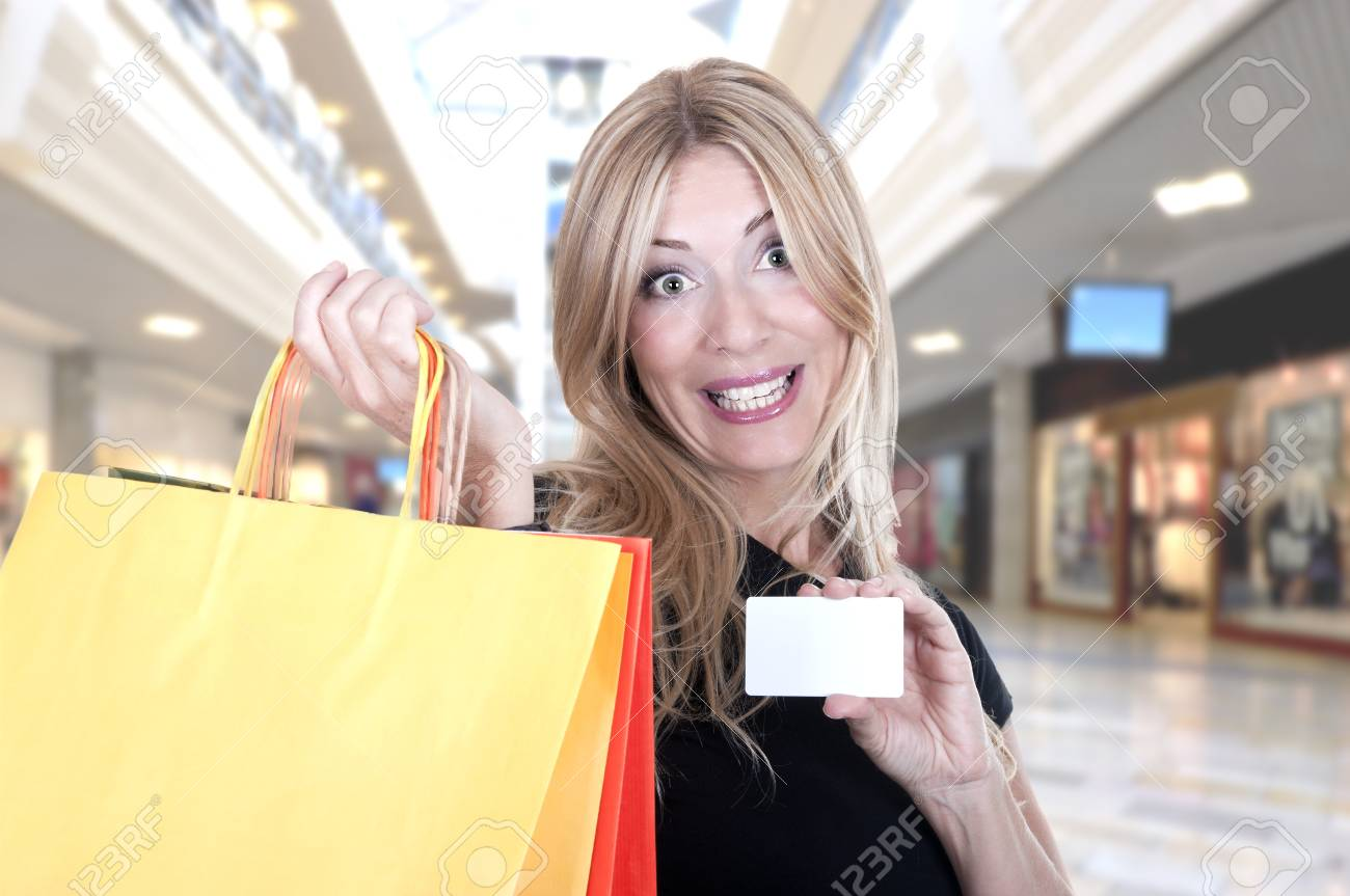 Portrait of the smiling blonde in shop with bags Stock Photo - 15262259