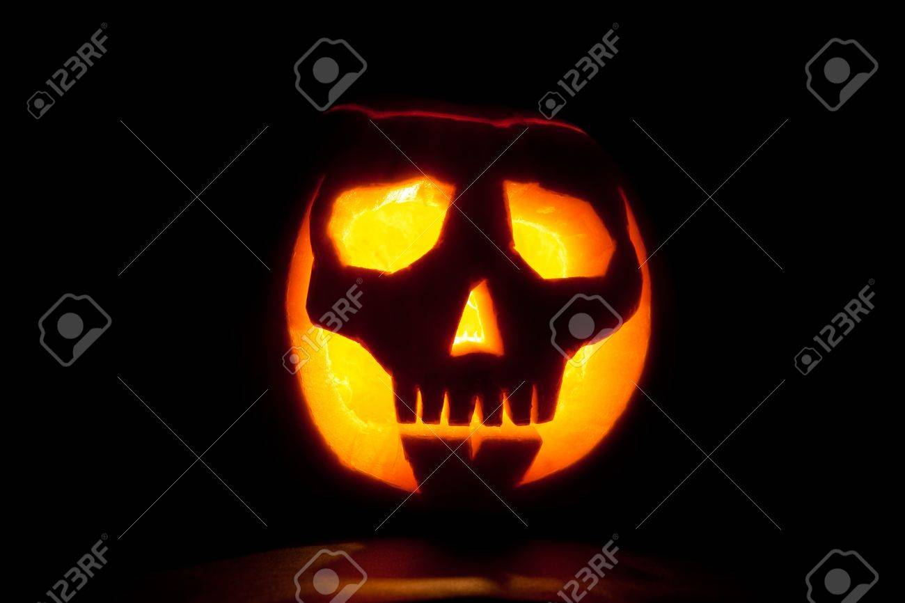 Skull Jack O Lantern Spooky Halloween Pumpkin Glowing In The Stock Photo Picture And Royalty Free Image Image 14497808
