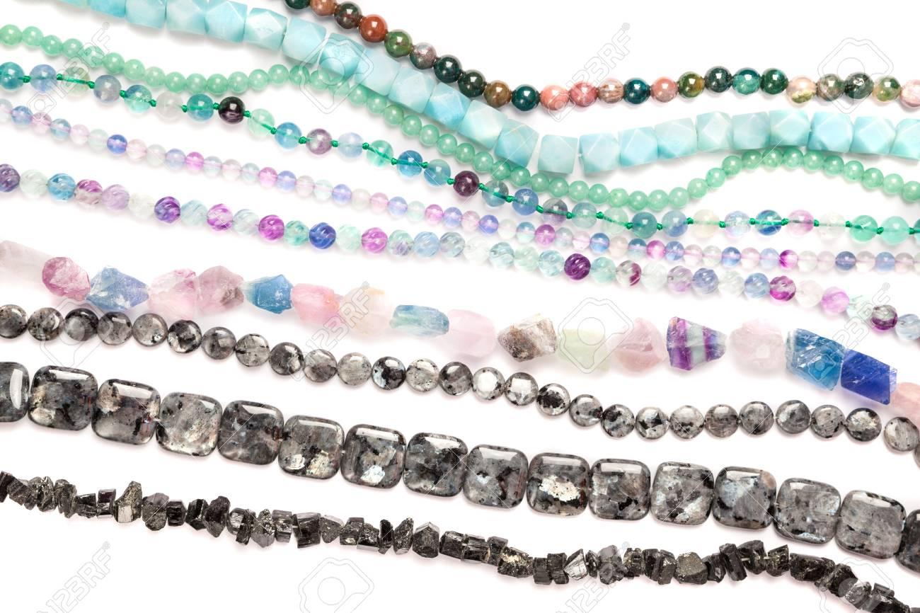 Natural semi-precious beads strands on white. Stock Photo - 21015162
