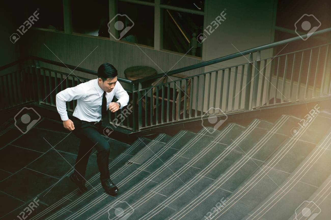 Motion Blue Young Asian Businessman Running On Staircase Go