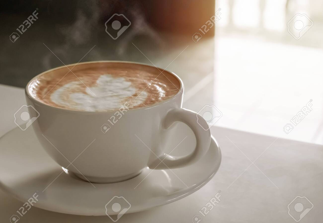 Hot coffee cup of latte art,coffee on wooden table in the morning. - 143123840