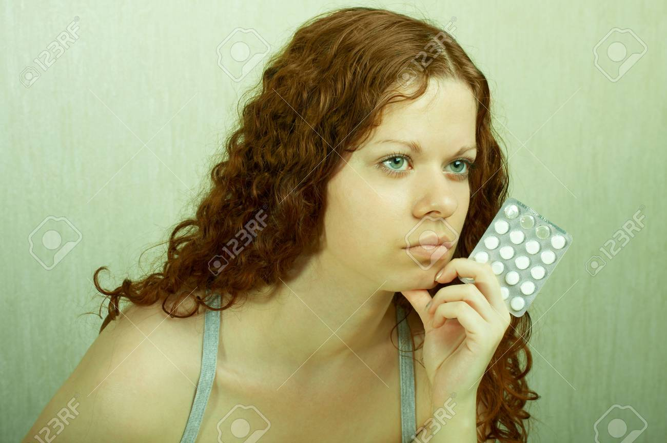 The thoughtful girl holds in a hand of a tablet and reflects on the developed situation Stock Photo - 3274950