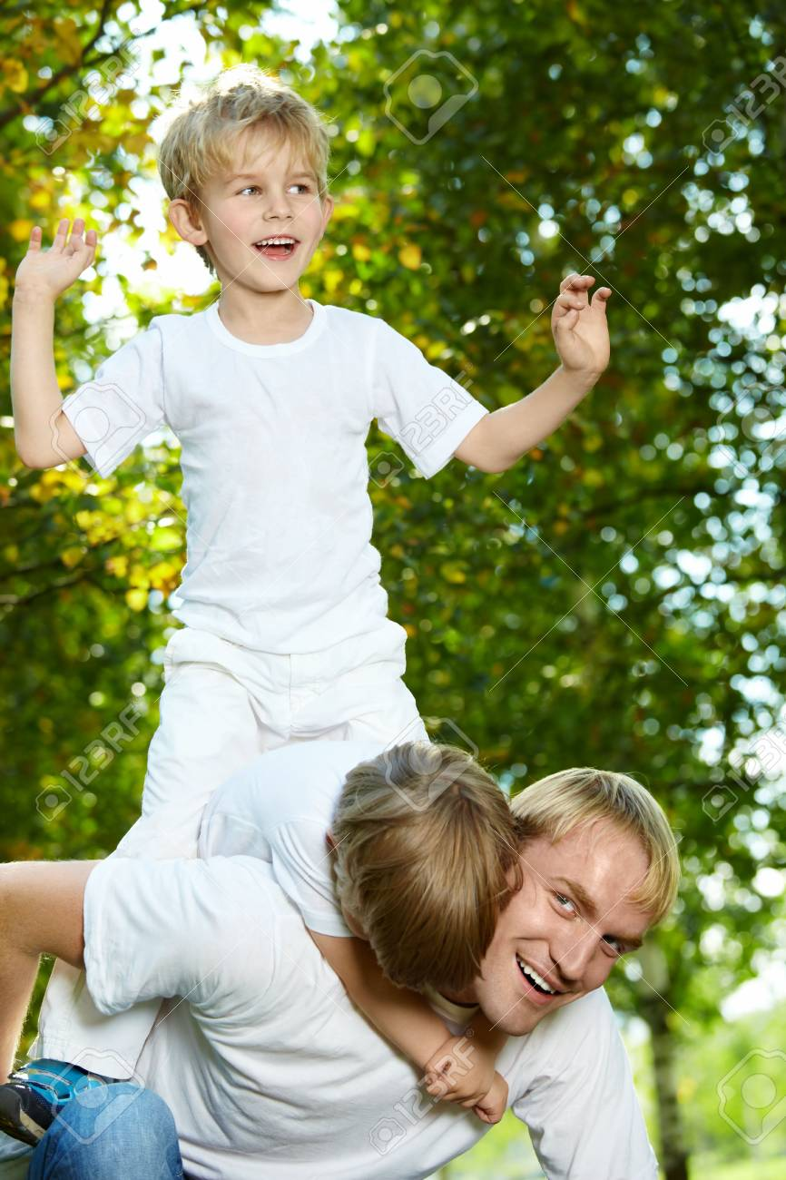 Father with two small sons frolic in park Stock Photo - 5593951