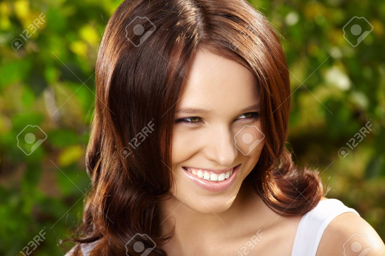 Delightful beauty with curly hair against magnificent vegetation Stock Photo - 5636263