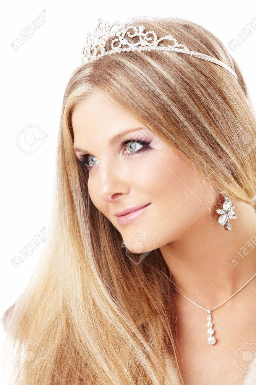 Portrait of charming blonde with a diadem on a head and the fur collar, isolated Stock Photo - 5901847