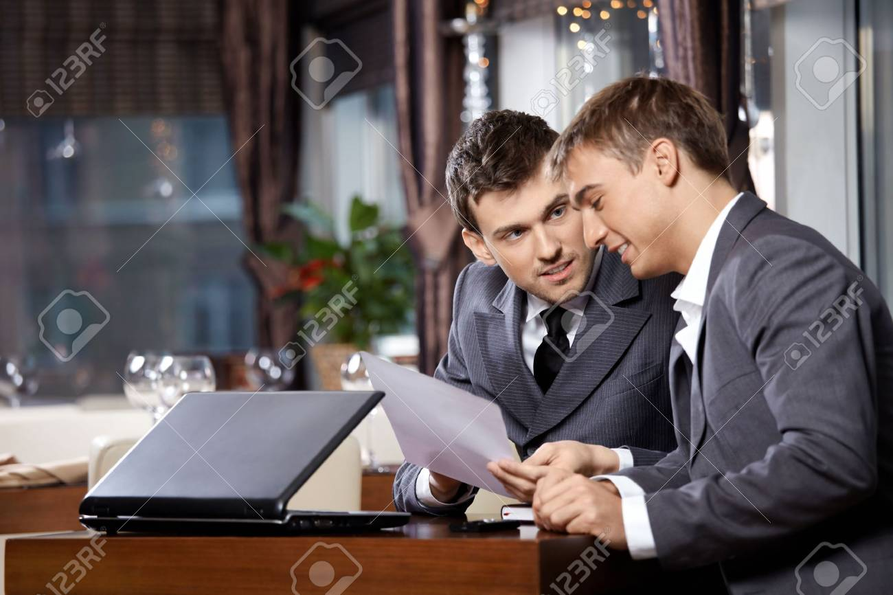 Two businessmen at restaurant discuss the document Stock Photo - 6328447