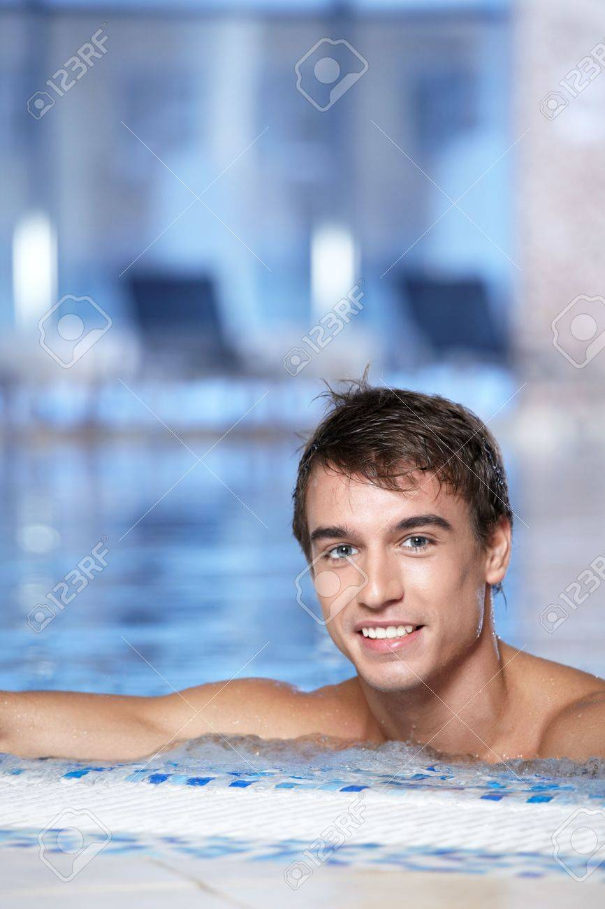 The attractive guy is at a side in pool Stock Photo - 6468379