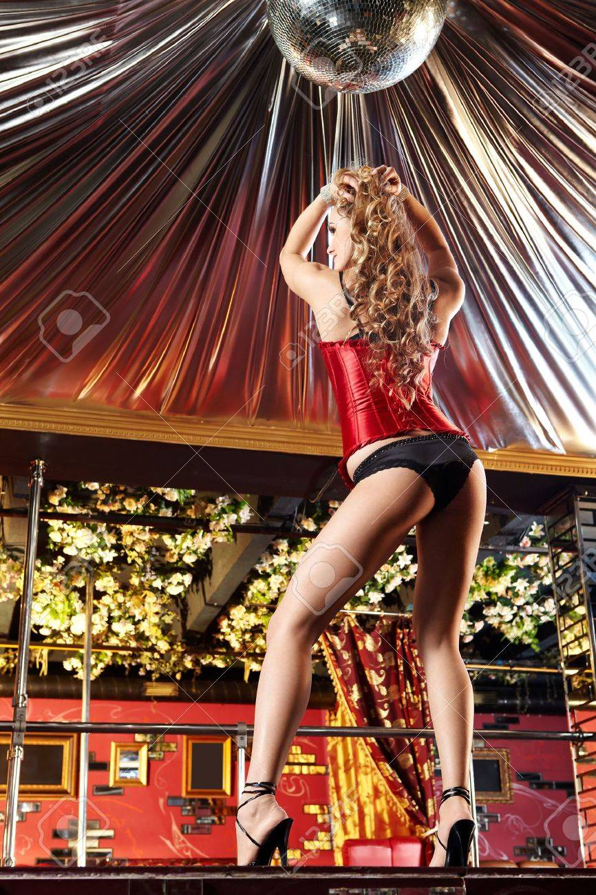 The attractive girl dances a striptease in club Stock Photo - 6439828