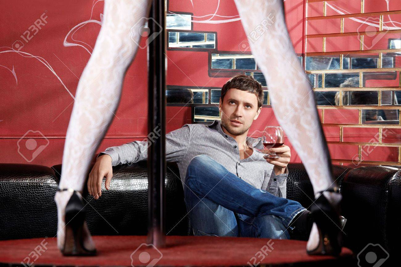 The man looks at a striptease in club Stock Photo - 6439830