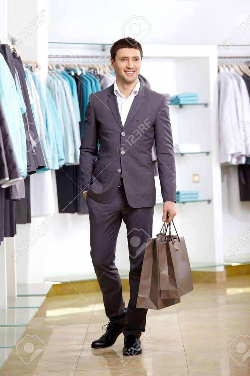 The Young Man With A Bag In Shop Stock Photo, Picture And Royalty ...