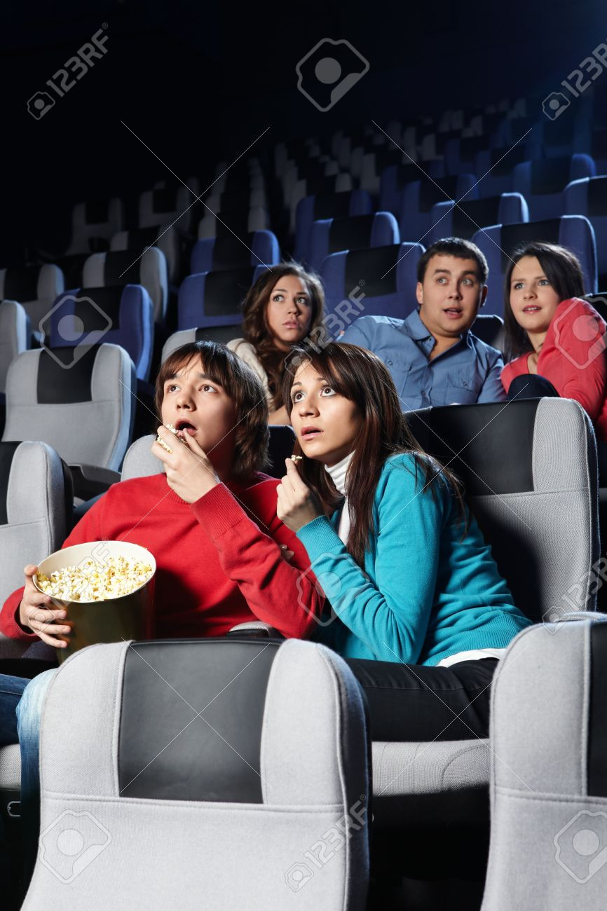 Group of young people look a film at a cinema Stock Photo - 7841950