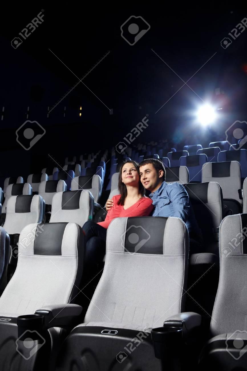 The happy enamoured couple looks cinema Stock Photo - 7841780