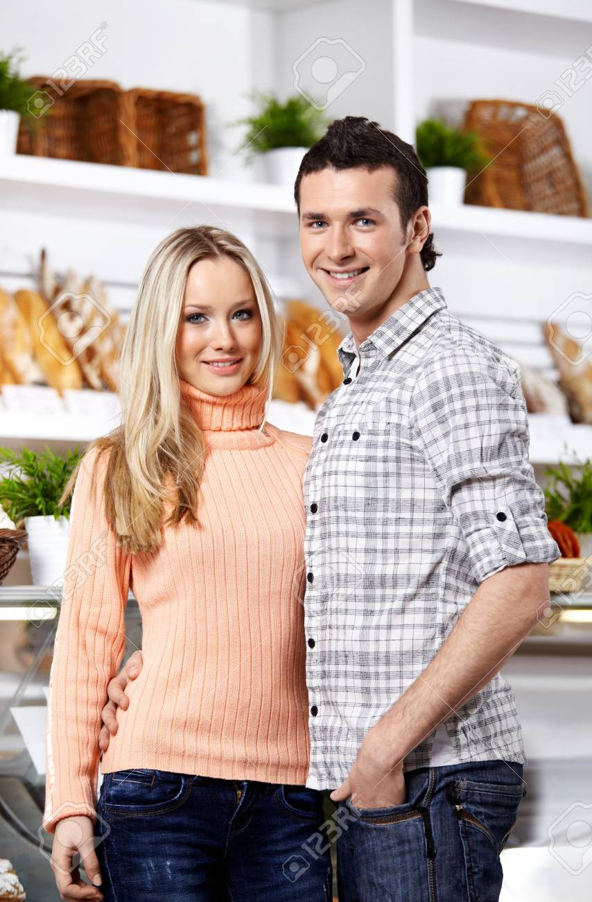 Happy young people in food shop look in the chamber Stock Photo - 7842028