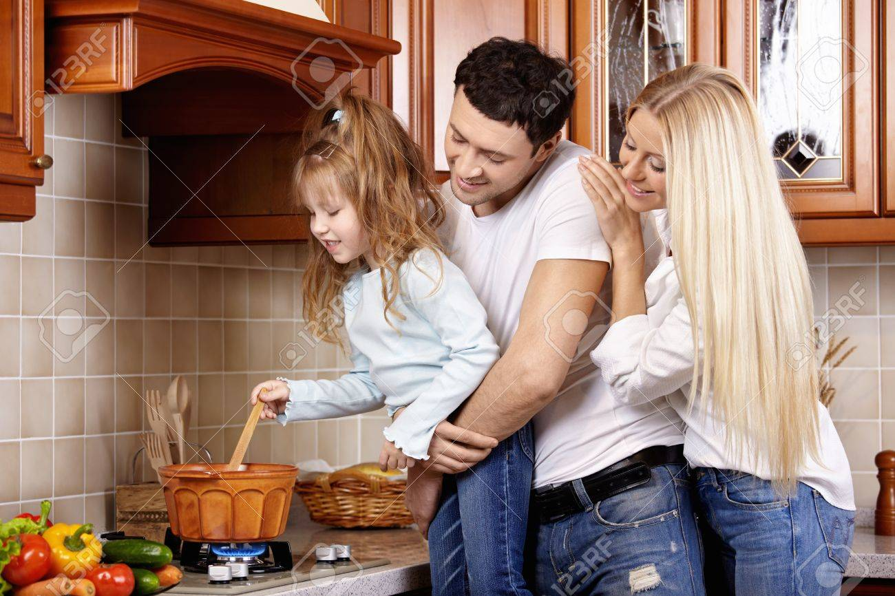 the happy family from three persons prepares in kitchen stock, Kitchen design