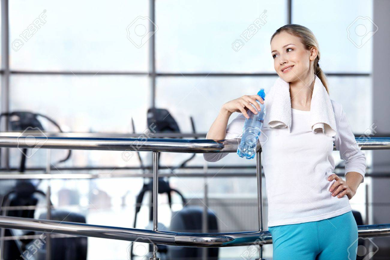 Portrait of the girl in the sports form in fitness club Stock Photo - 7861505