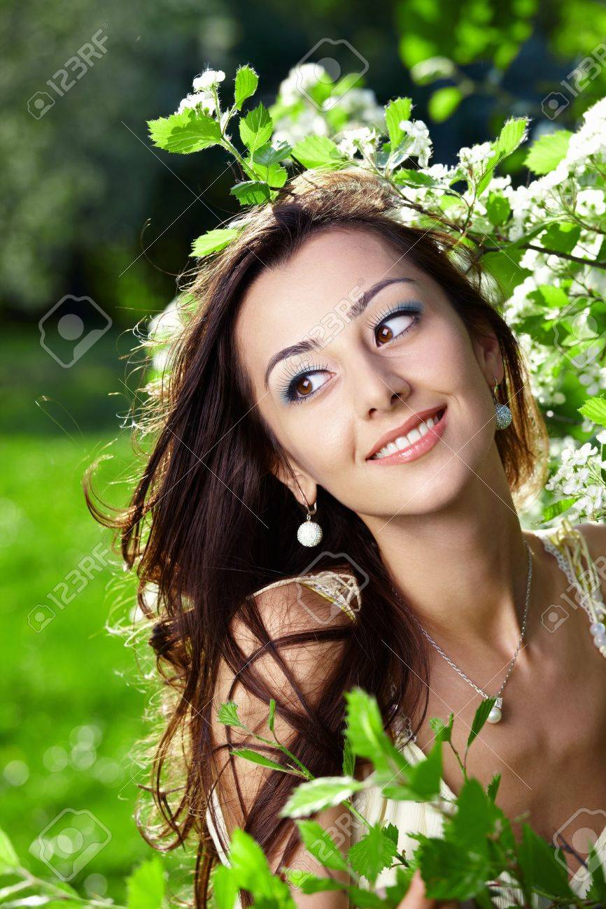 The beautiful young girl in blossoming trees Stock Photo - 7861605
