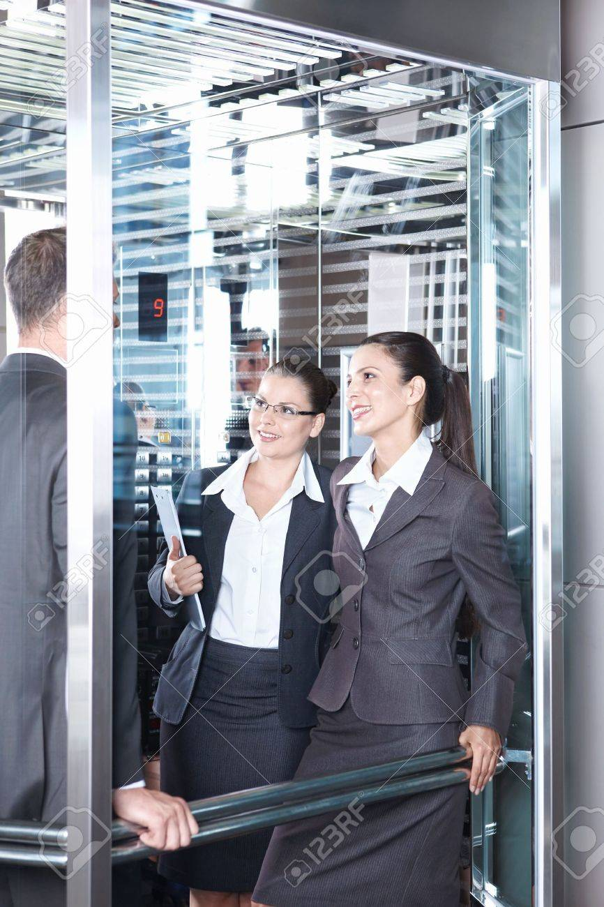 Business people traveling in an elevator Stock Photo - 7952620