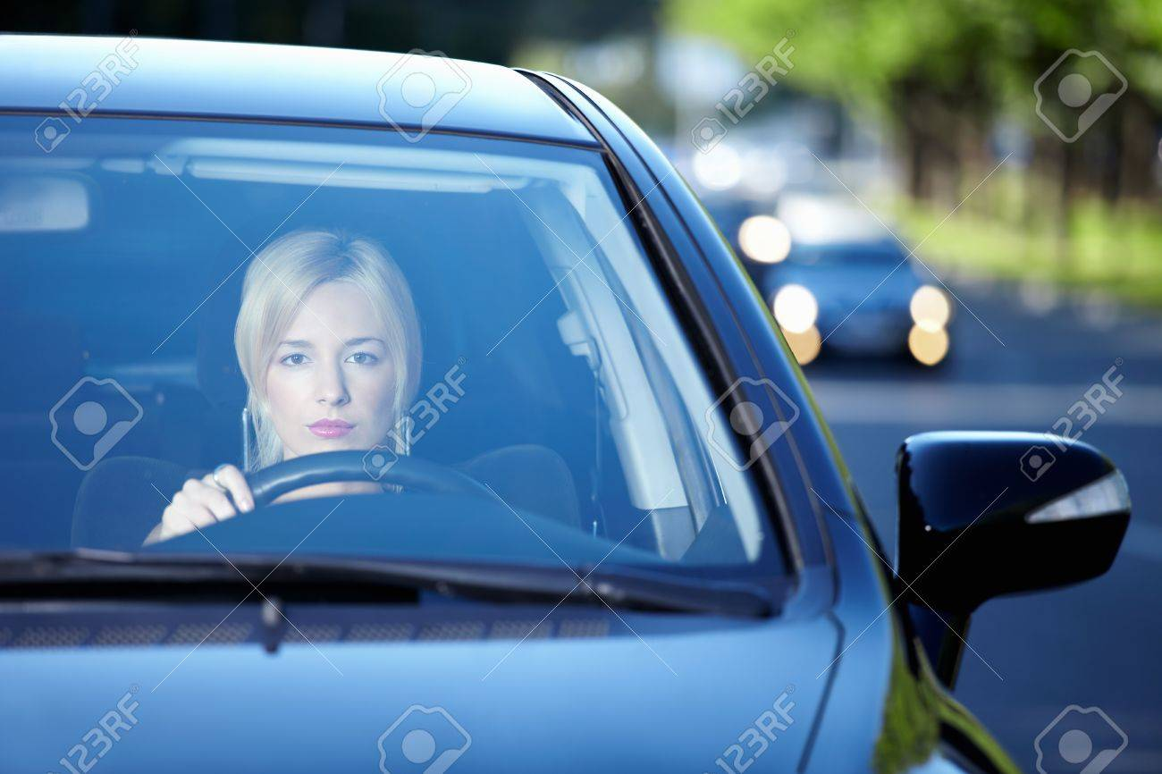 Young attractive girl behind the wheel Stock Photo - 7945049