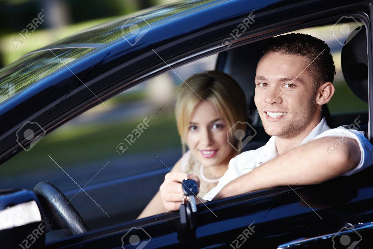 Young couple in the car with the keys of the car Stock Photo - 7944786