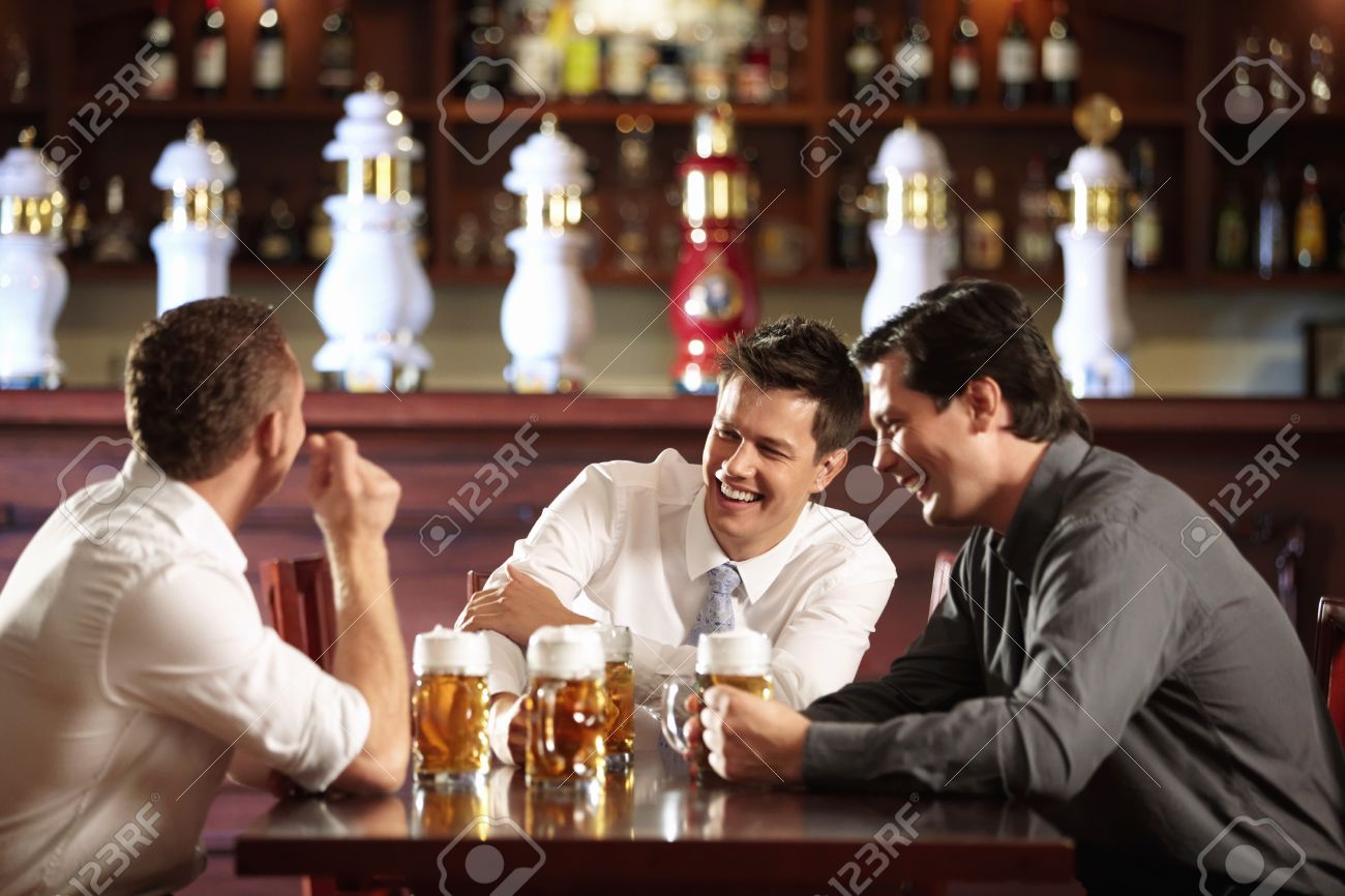 Three men in shirts in the bar Stock Photo - 8096738