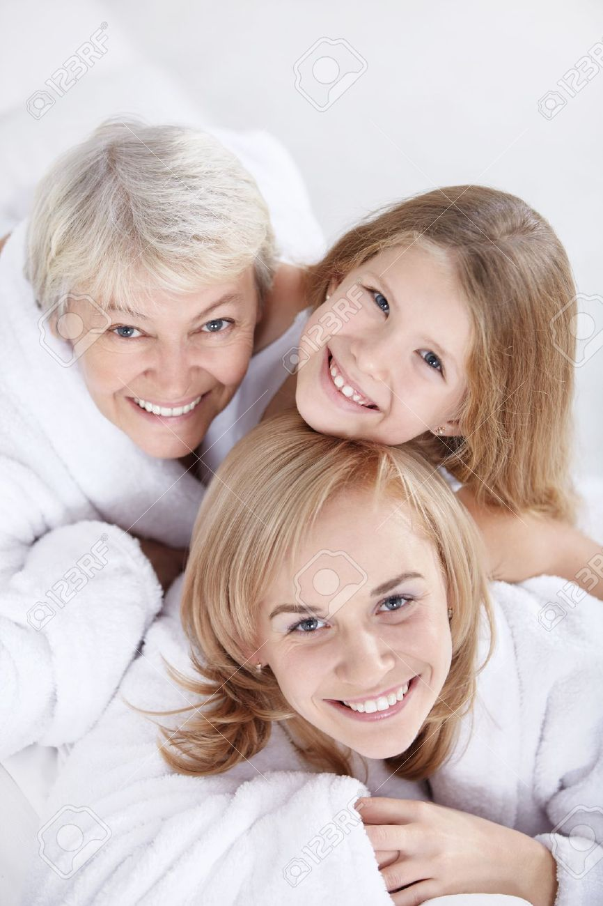 Portrait of three women on a white Stock Photo - 8417429