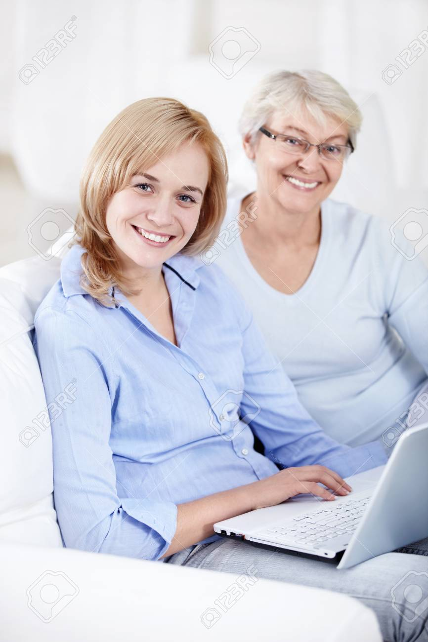 Attractive woman with a laptop Stock Photo - 8441826