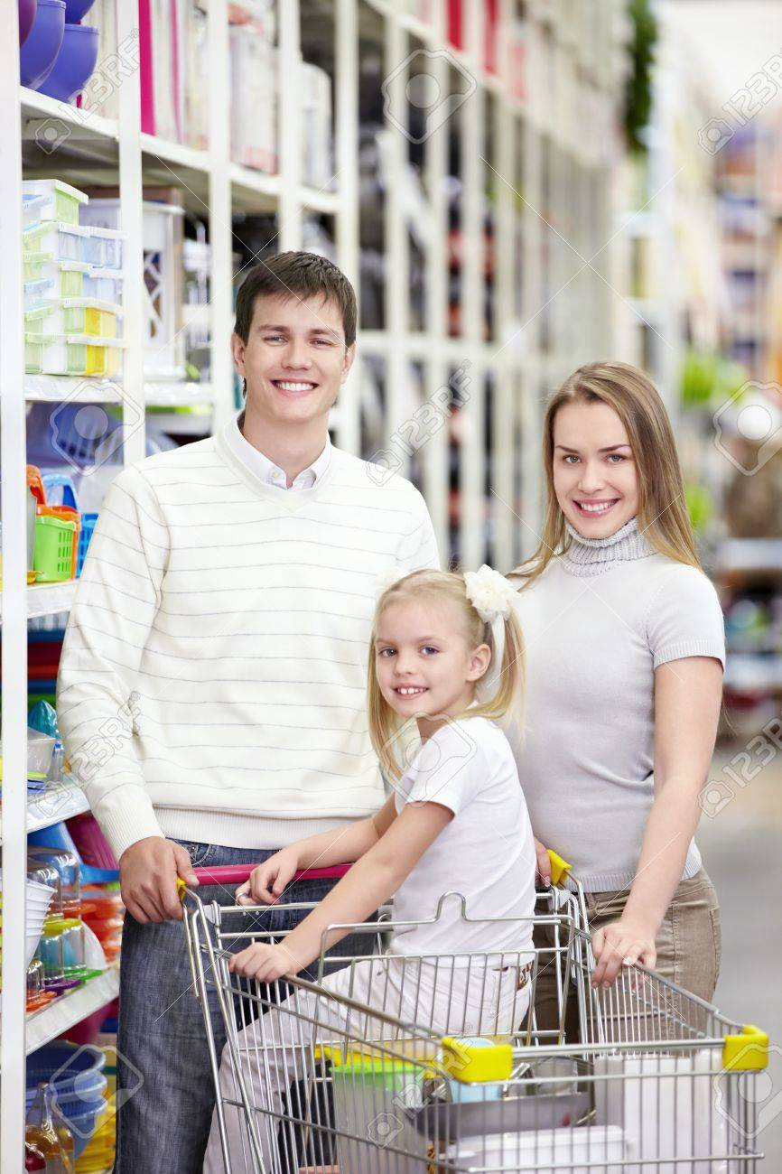 A young family is shopping in a store Stock Photo - 8800391
