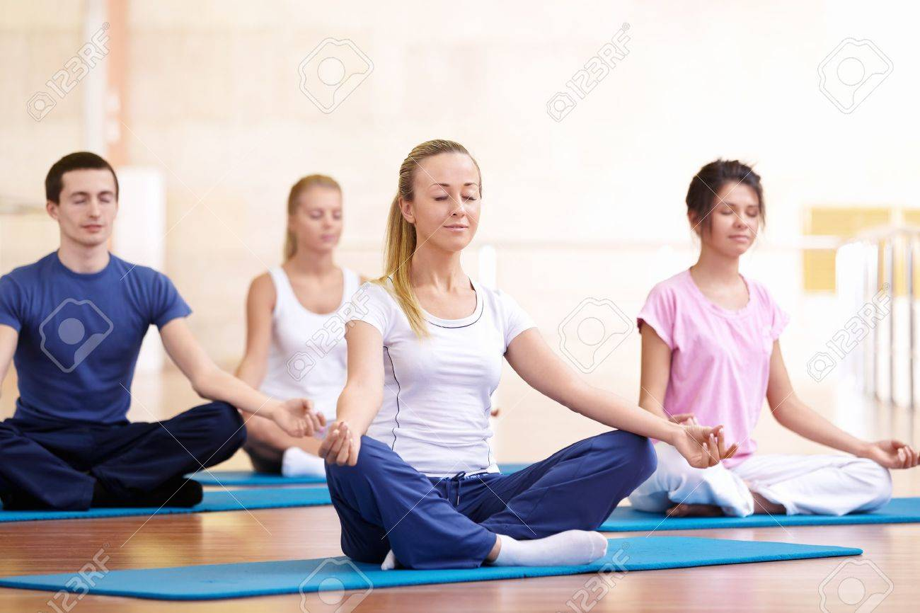 Attractive young people meditate Stock Photo - 8968809