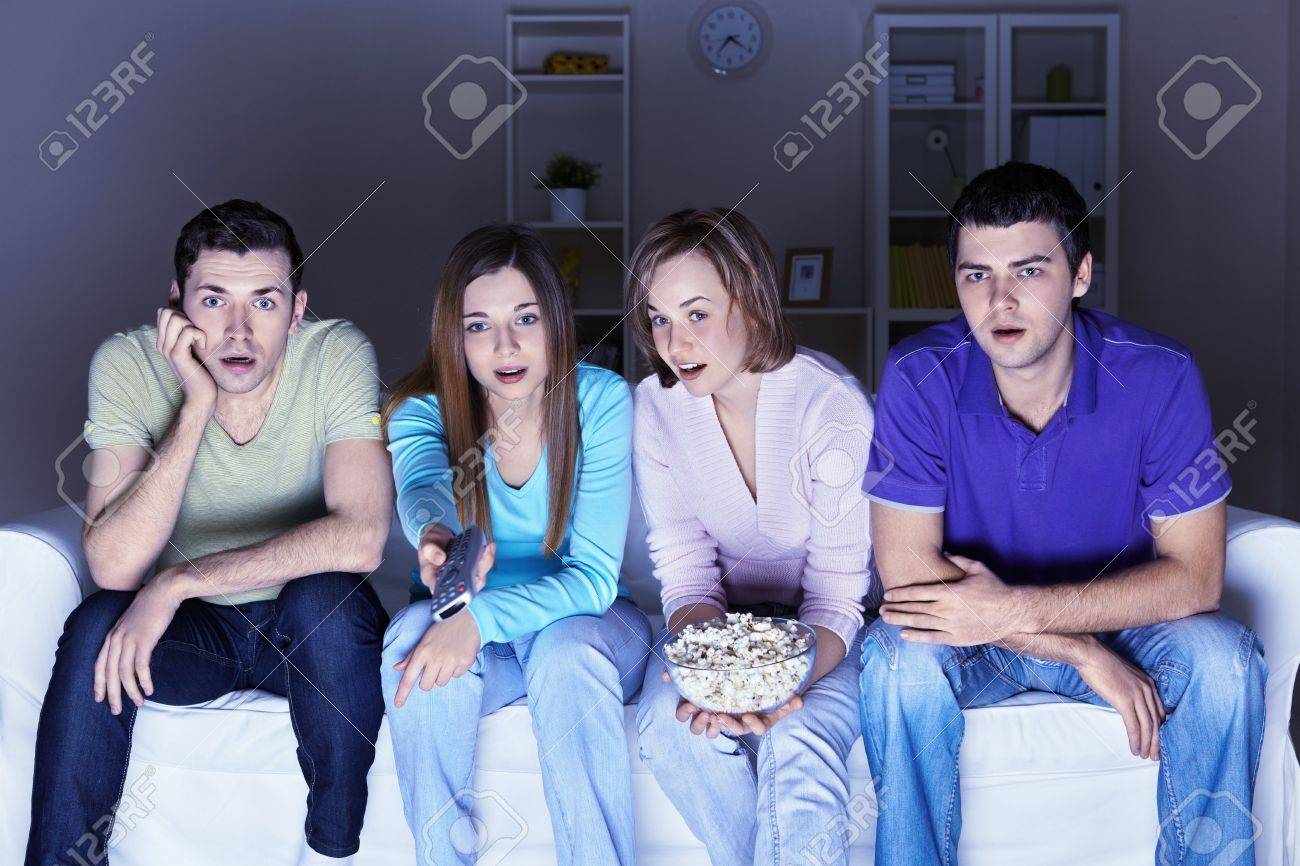 Surprised people are watching a movie Stock Photo - 9075350