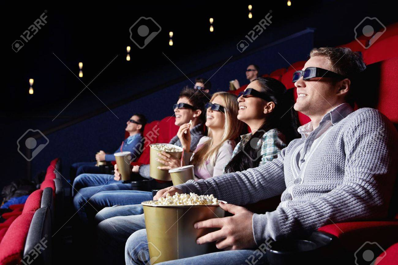young people watch movies in cinema stock photo picture and royalty
