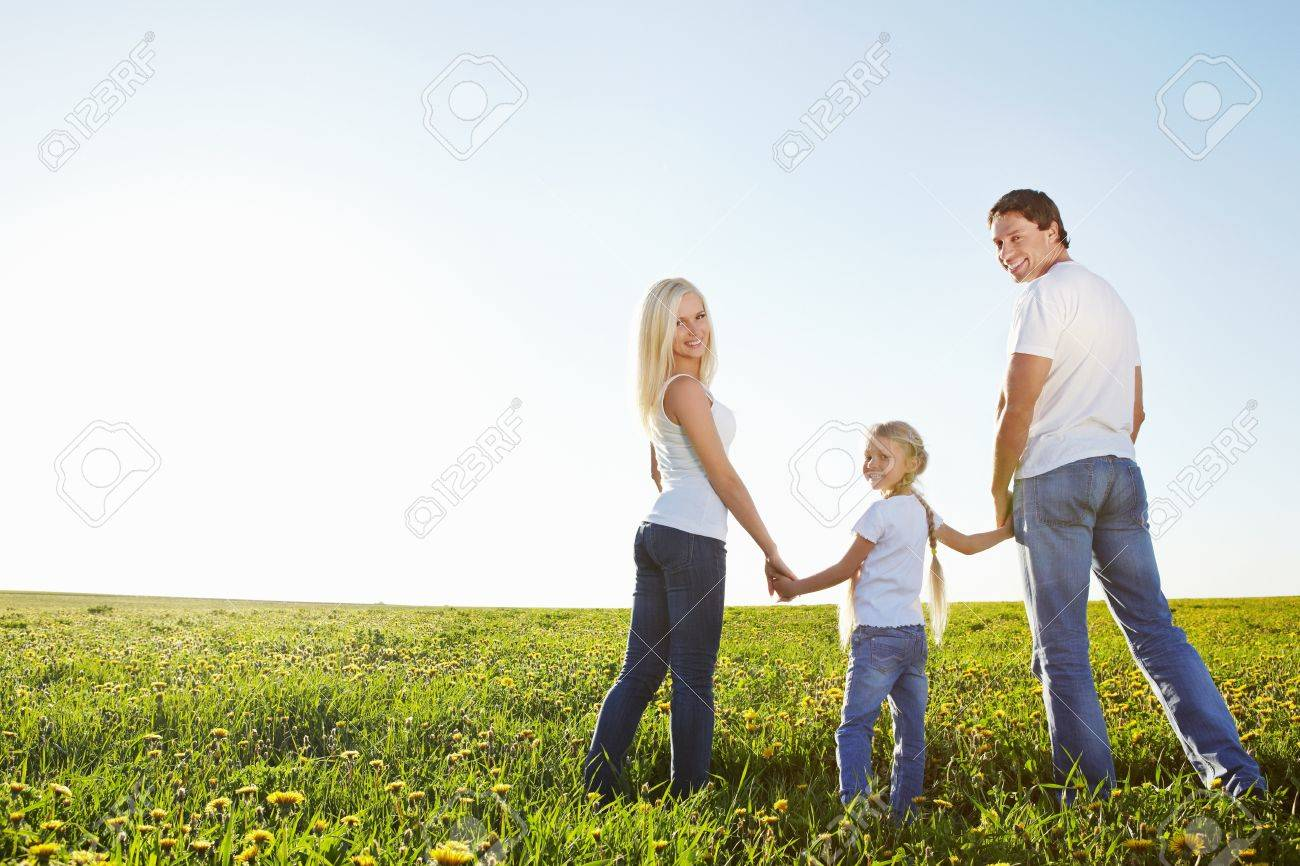 Happy family in the lush field Stock Photo - 9695106
