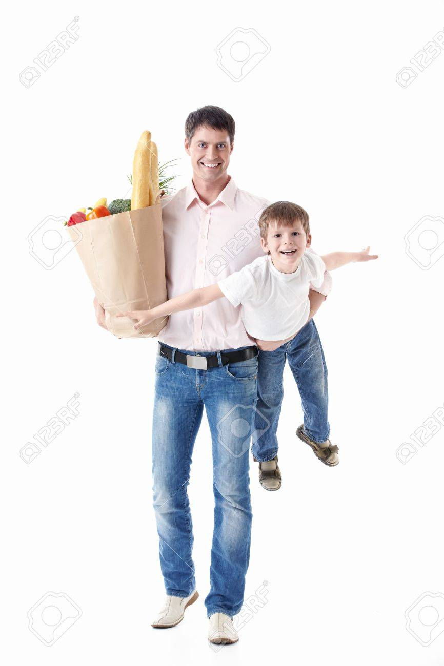 A Man With A Baby And A Bag Of Food On A White Background Stock ...