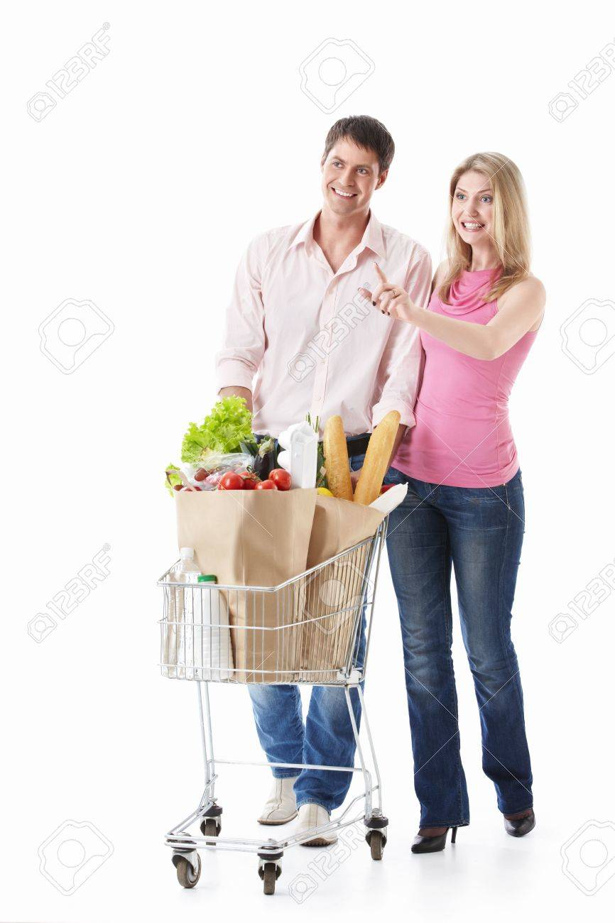 The happy couple with a cart with food on a white background Stock Photo - 9794541