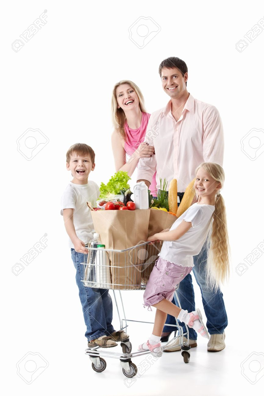 Family with cart with purchases isolated Stock Photo - 9824743