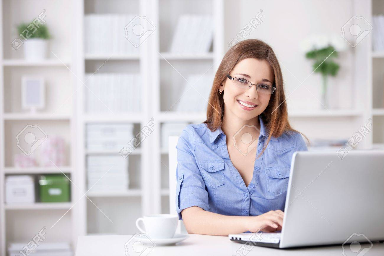 Young beautiful girl with a laptop at home Stock Photo - 9997054