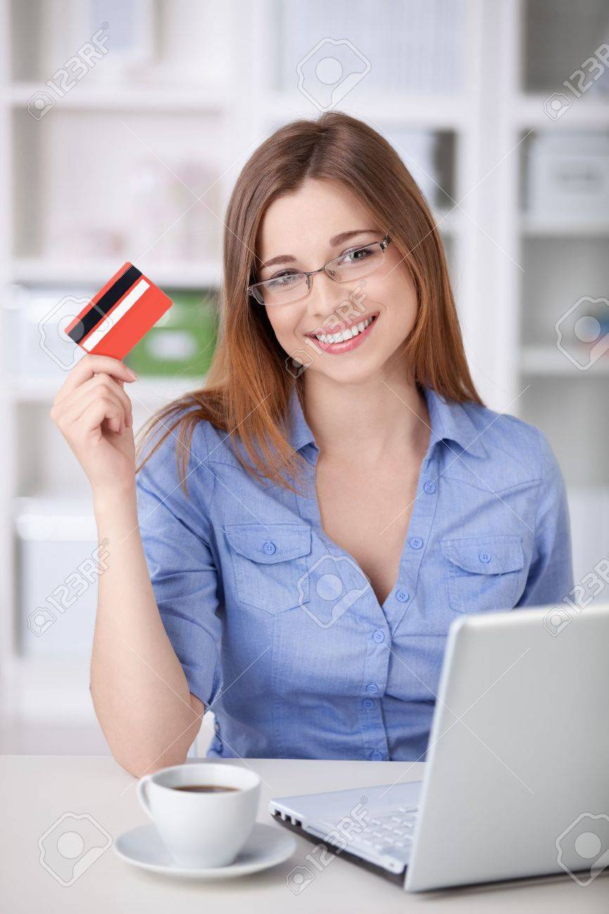 A beautiful girl with a laptop and a credit card at home Stock Photo - 9997056