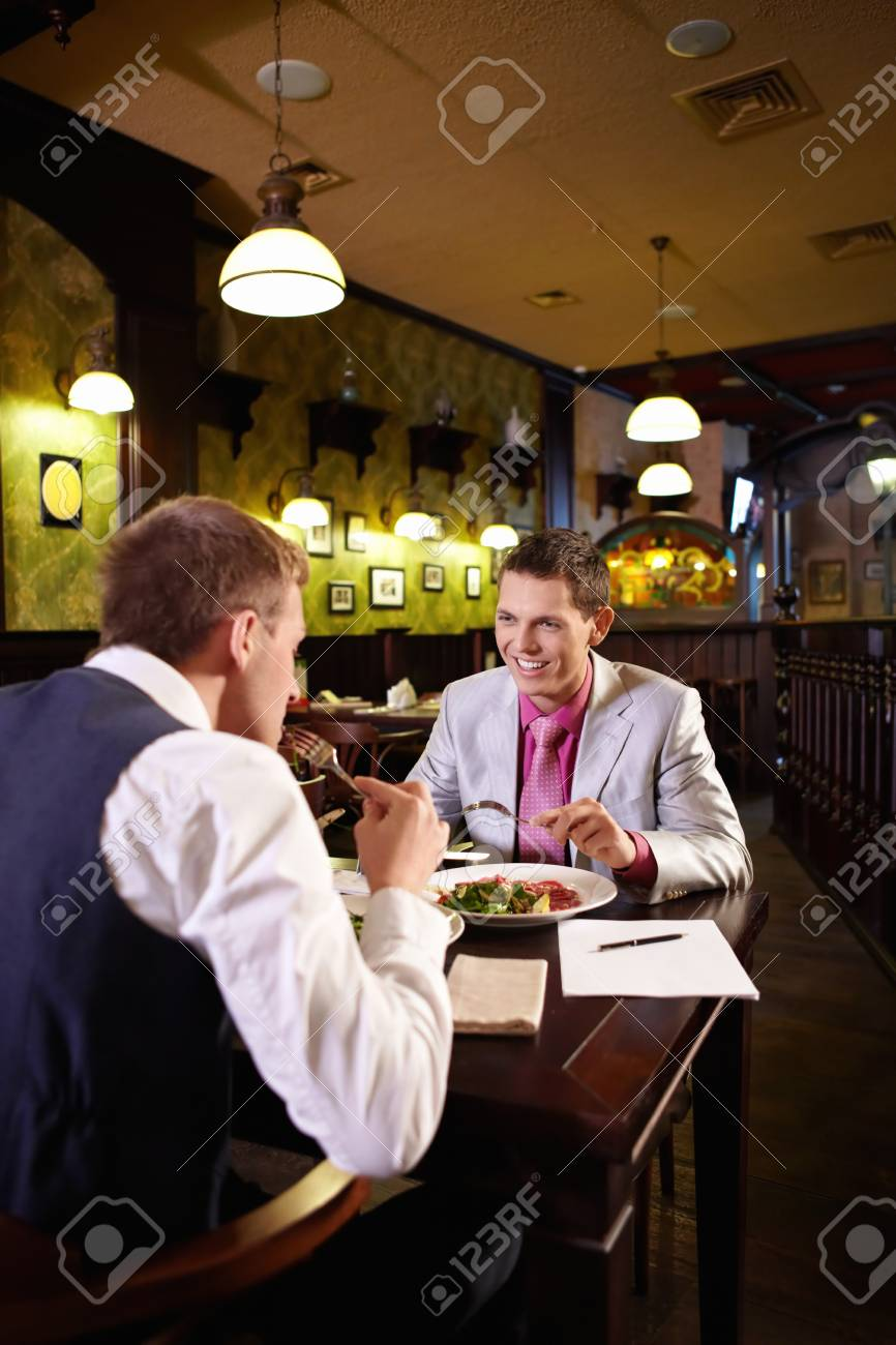 Two men having lunch in a restaurant Stock Photo - 9997048