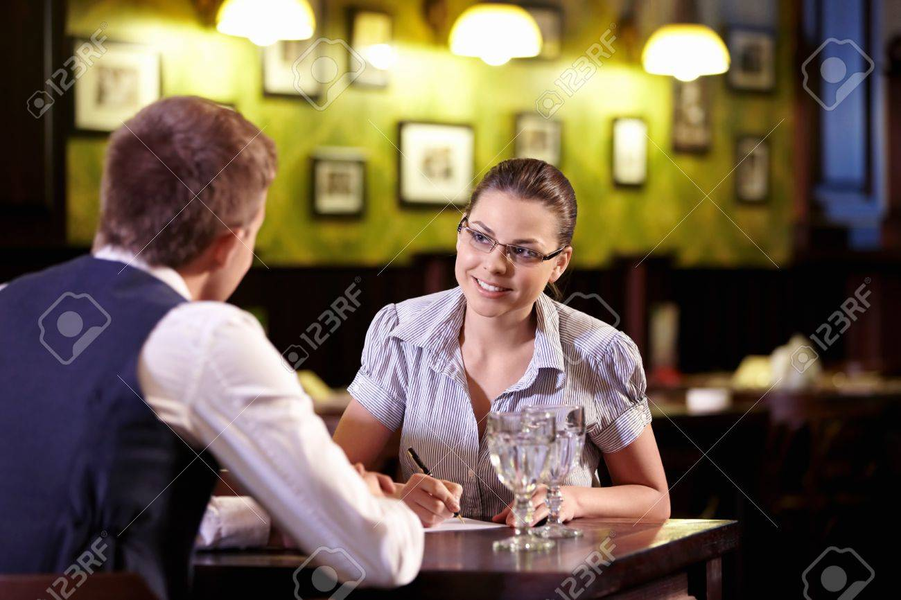 a young girl writes in a restaurant stock photo picture and a young girl writes in a restaurant stock photo 9997032