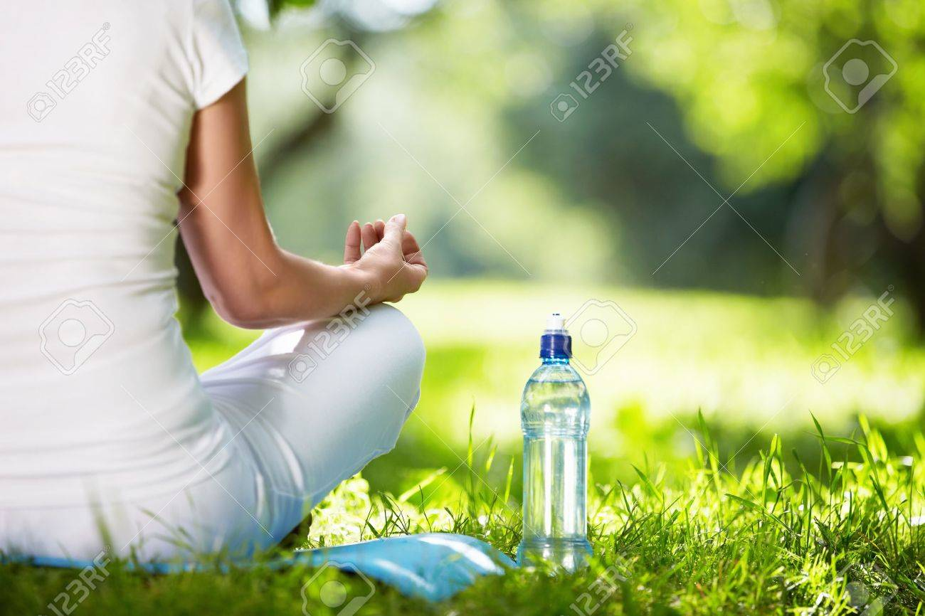 Woman in lotus position close-up Stock Photo - 10432061