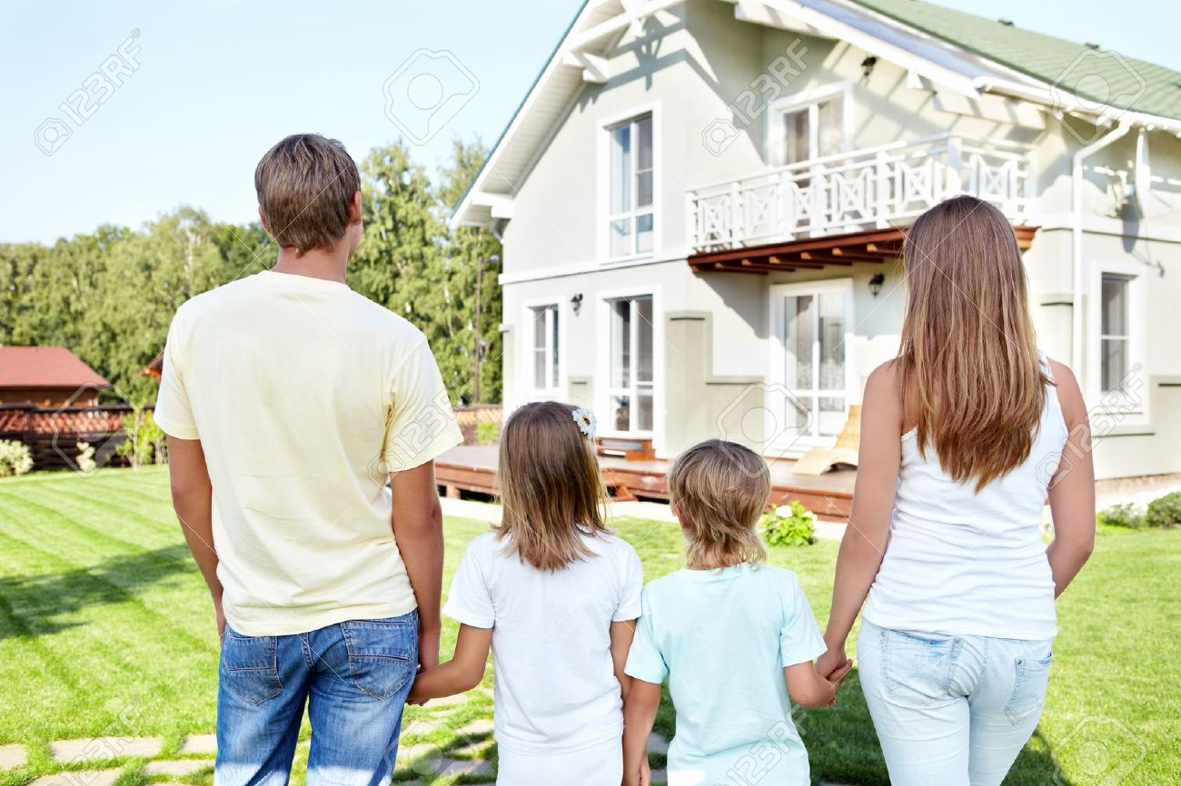 Family In Front Of House Stock Photos. Royalty Free Family In ...