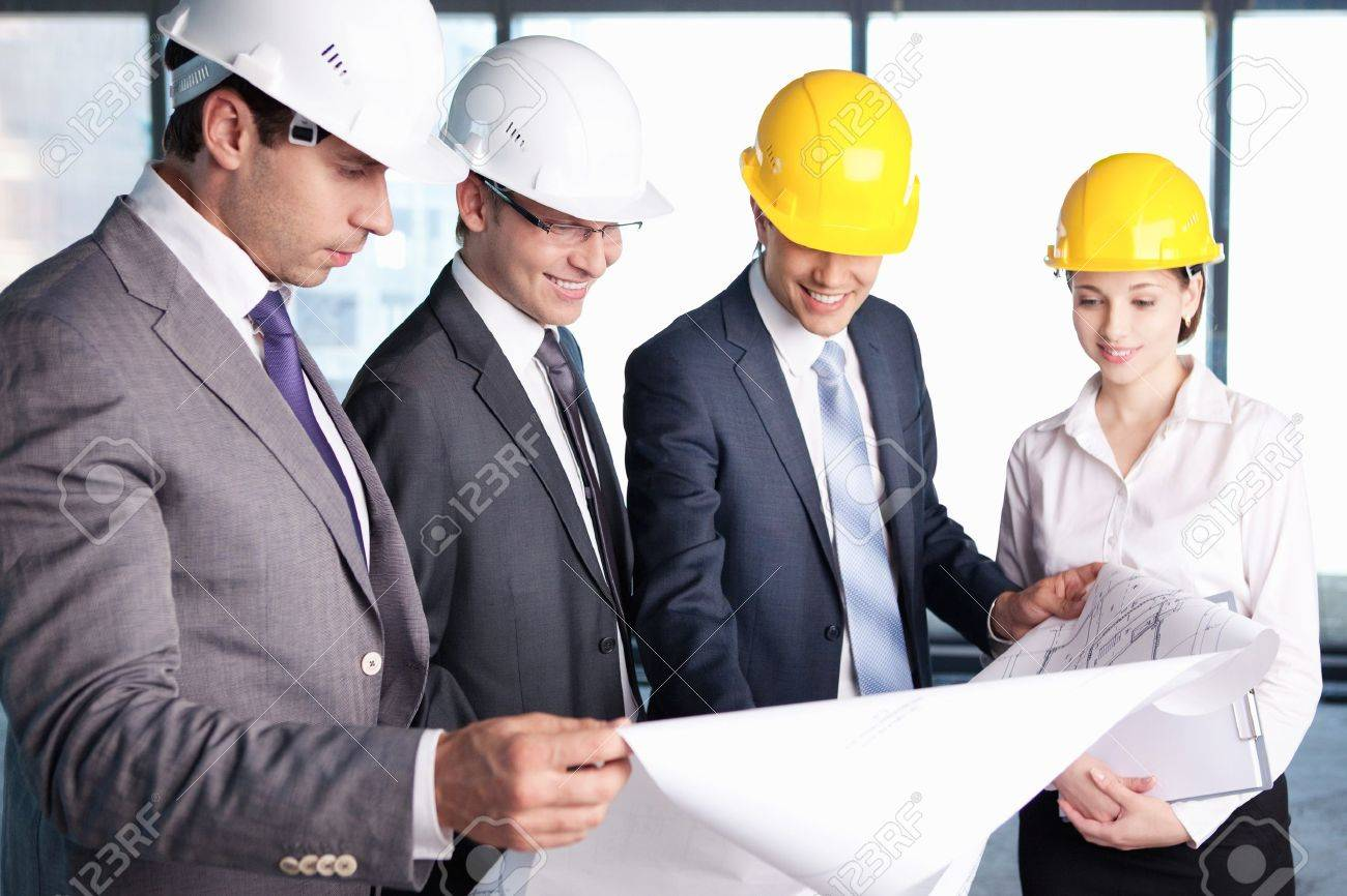 Business people in hard hats at construction site Stock Photo - 10777598