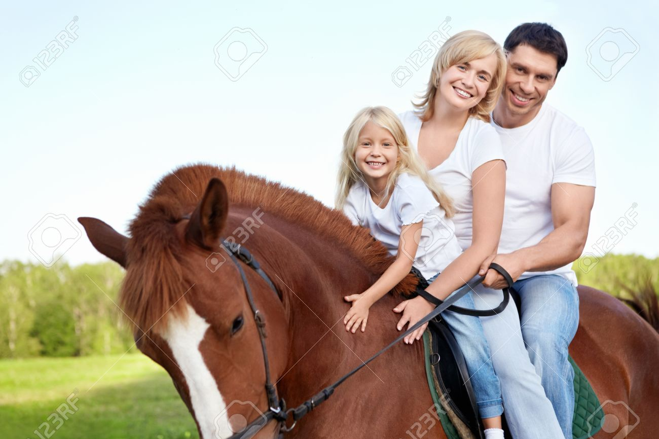 Attractive Family On A Brown Horse Stock Photo Picture And Royalty Free Image Image 11698753