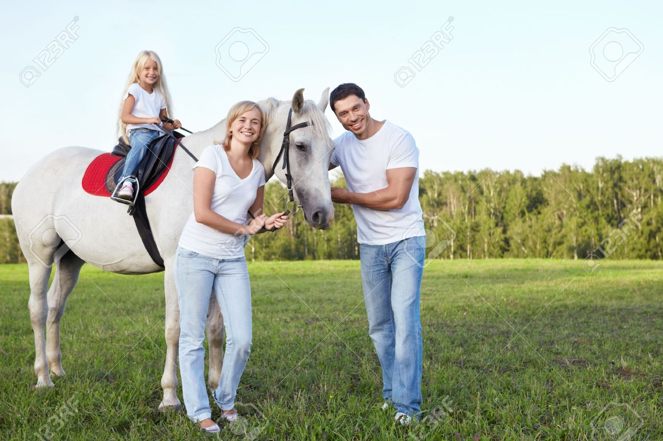 Family With A Child On A Horse Stock Photo Picture And Royalty Free Image Image 11699027