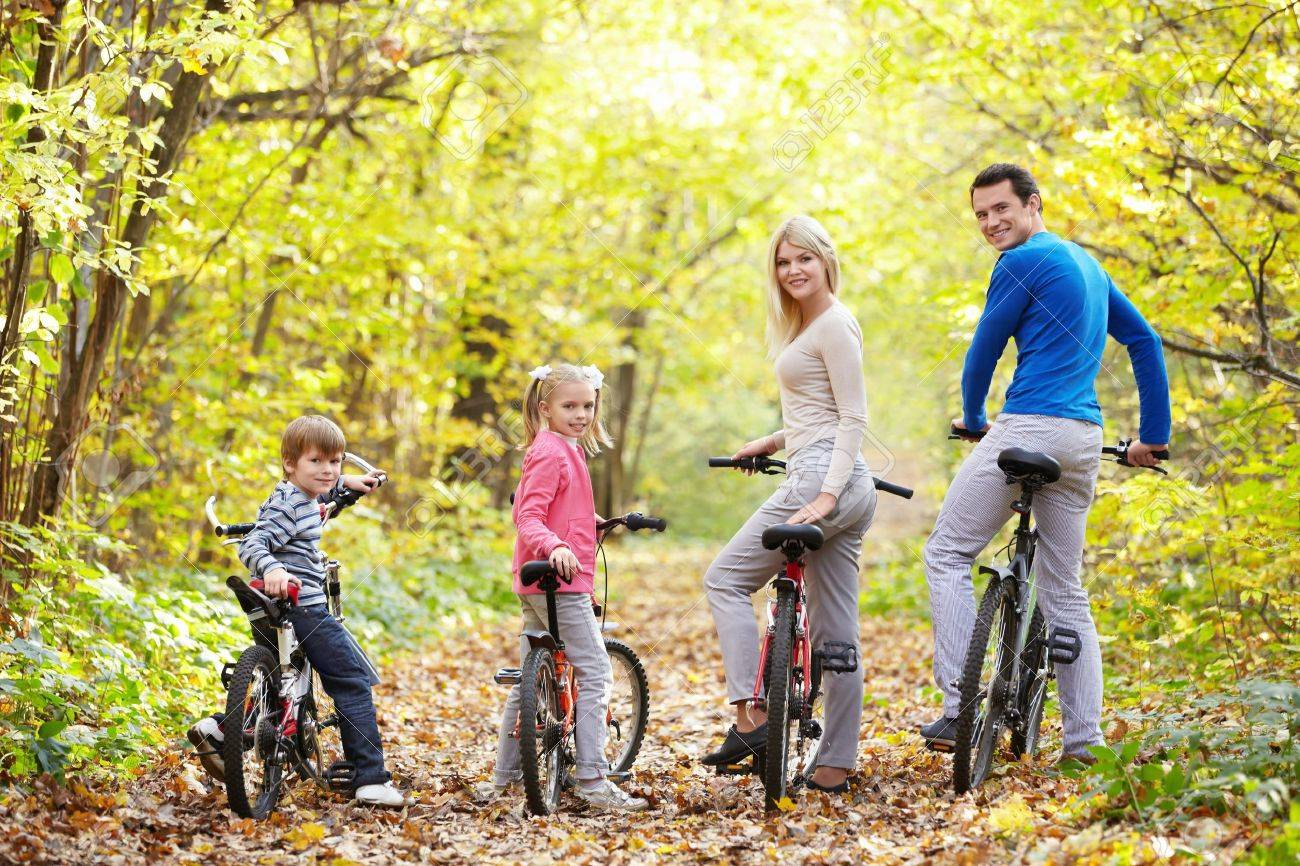 Family on bikes in the park in autumn Stock Photo - 11989476
