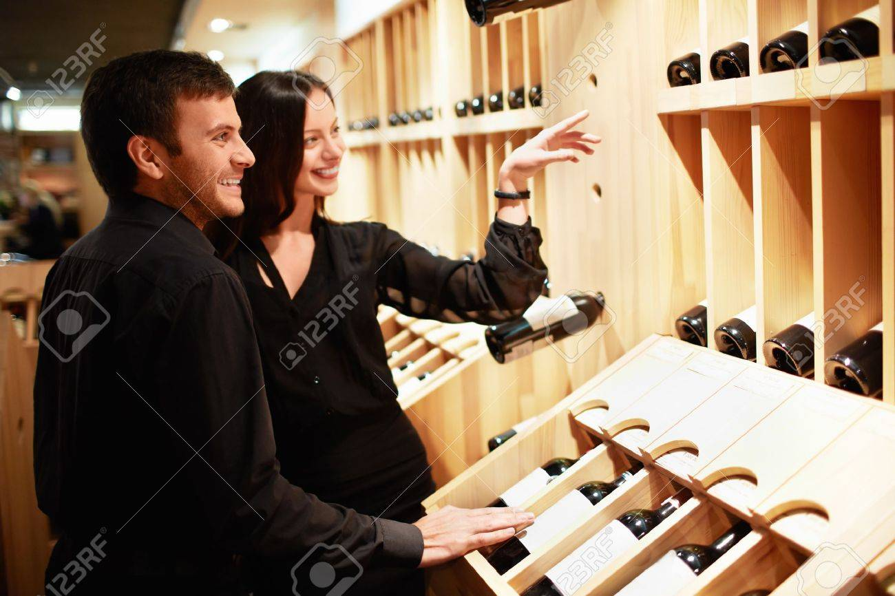 Young couple chooses the wine Stock Photo - 14645753