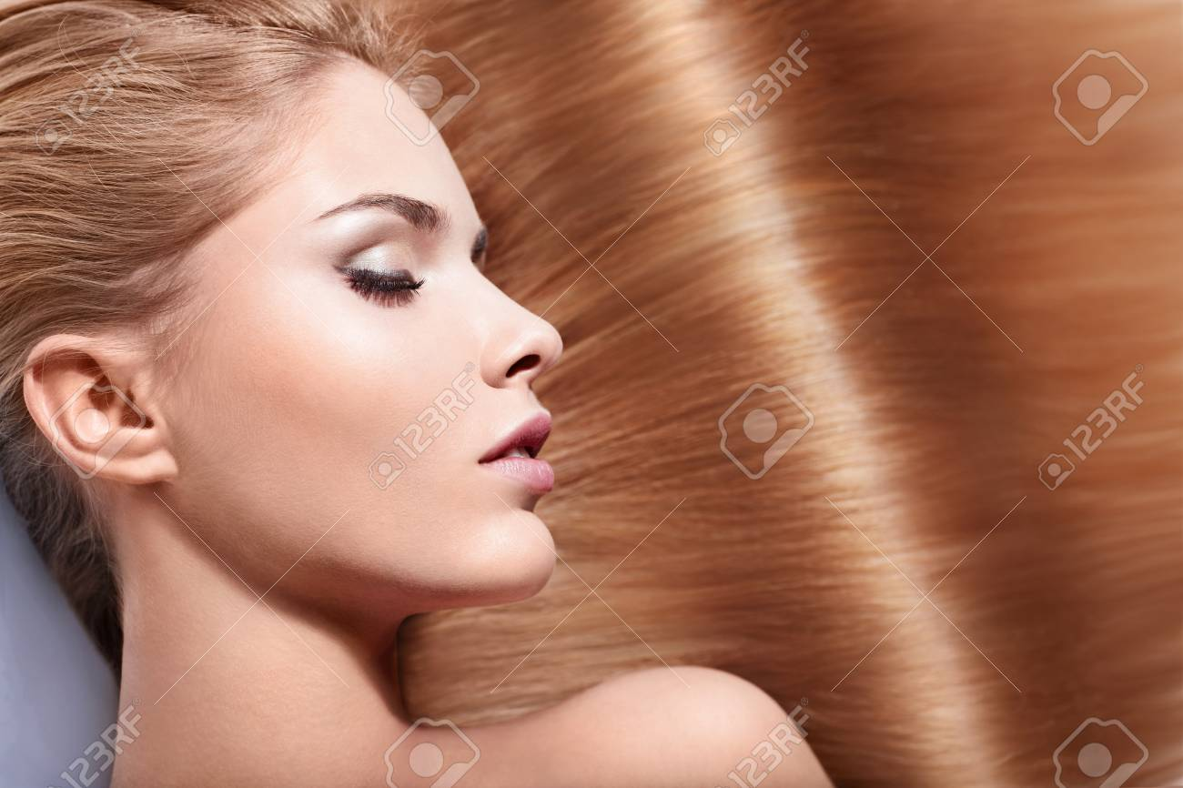 Beautiful girl with shiny hair Stock Photo - 15501857